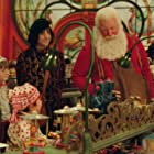 Tim Allen, Spencer Breslin, and David Krumholtz in The Santa Clause 2 (2002)