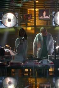 Eva LaRue and Christian Clemenson in CSI: Miami (2002)