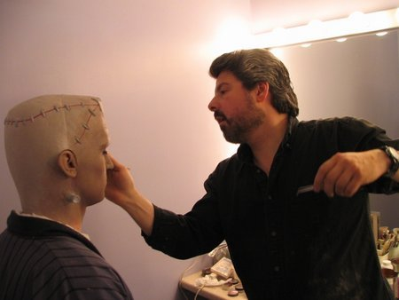 Makeup-Fx artist Norman Bryn working on actor Conor Timmis.