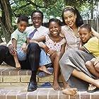 Don Cheadle, Mosa Kaiser, Sophie Okonedo, Ofentse Modiselle, and Mathabo Pieterson in Hotel Rwanda (2004)