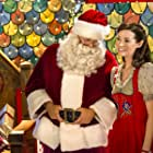 Summer Glau as an elf helping a family to rediscover the Christmas spirit.