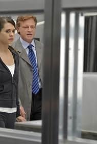 Patrick Garrow and Lyndsy Fonseca in Nikita (2010)
