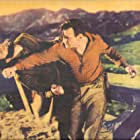 Ward Bond and Buck Jones in Unknown Valley (1933)