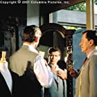 Tailor Harry Pendel (Geoffrey Rush, right) may be known for his fine suits, but British spy Andrew Osnard (Pierce Brosnan) has more than haberdashery to discuss with the ex-con