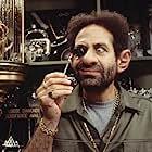 Tony Shalhoub stars as Jeebs, an alien Pawnshop owner