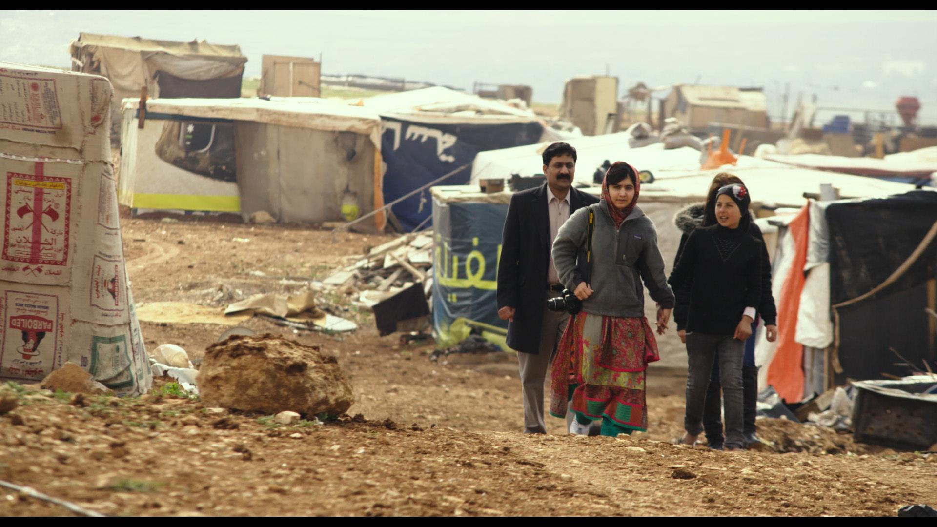 Zia Yousafzai and Malala Yousafzai and Syrian refugee Rimah in Syrian Refugee Tent Camp in Jordan.