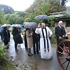 The Priest leads the mourners at Dermot's funeral