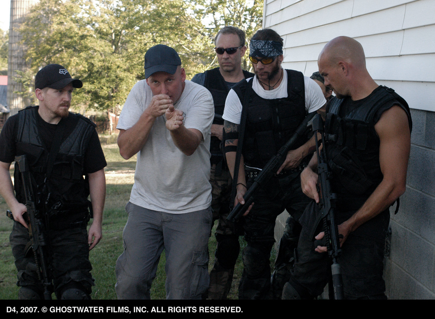 Michael Henderson instructs the cast on weapons handling and team movement during pre-production training.