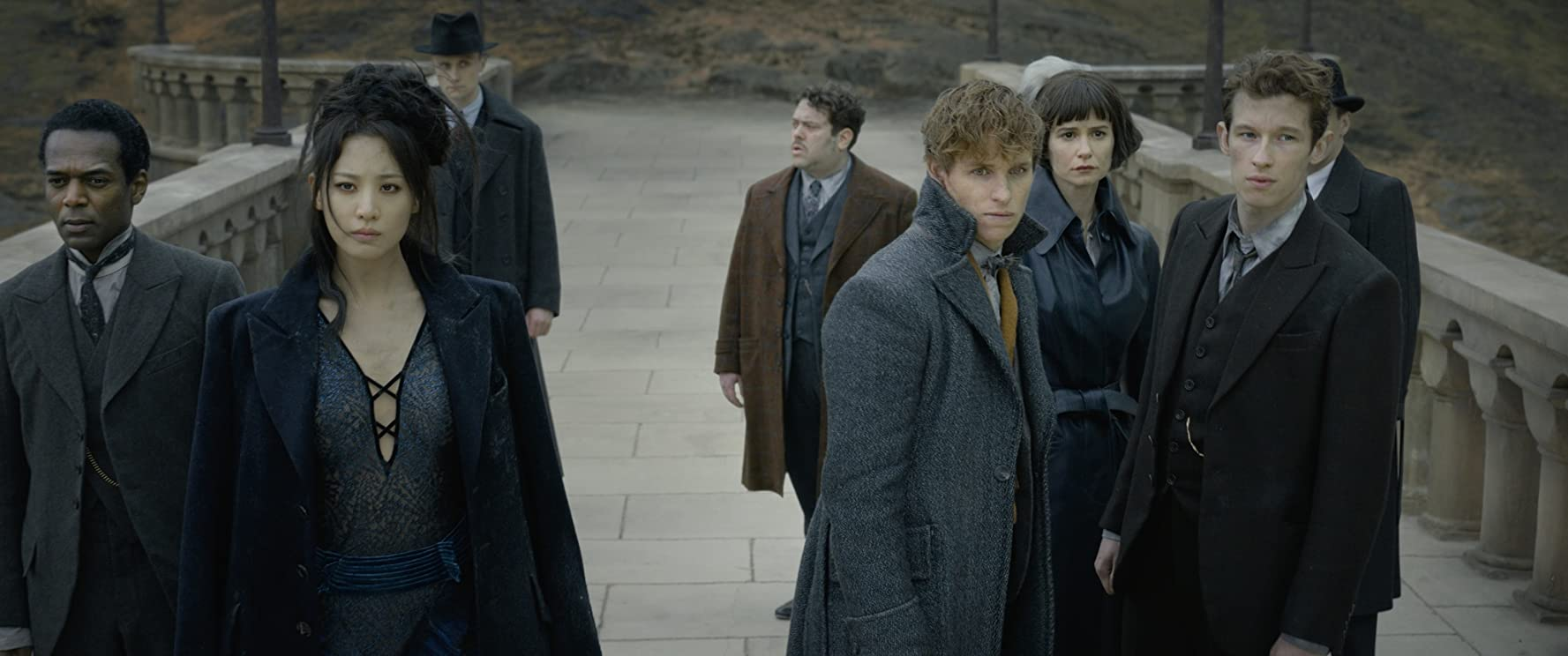 Dan Fogler, William Nadylam, Eddie Redmayne, Katherine Waterston, Claudia Kim, and Callum Turner in Fantastic Beasts: The Crimes of Grindelwald (2018)