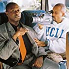 Hill Harper and Andre Braugher in Get on the Bus (1996)