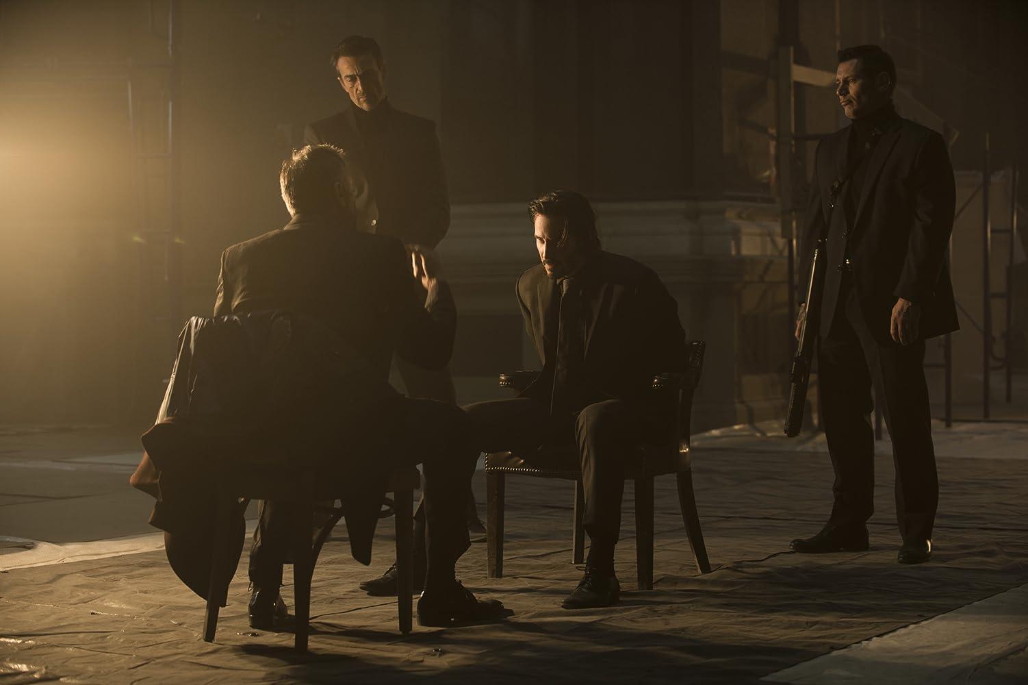 Keanu Reeves, Daniel Bernhardt, Michael Nyqvist, and Vladislav Koulikov in John Wick (2014)