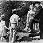 Robert Mitchum, Shelley Winters, Sally Jane Bruce, and Billy Chapin in The Night of the Hunter (1955)