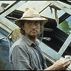 Michael Douglas in Romancing the Stone (1984)
