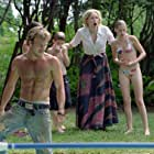 (From left to right) Dale (Stephen Dorff) comes to the aid of Jesse (Ryan Wilson), Leah (Sharon Stone), and Kristen (Kristen Stewart) when a large snake mysteriously appears in their swimming pool.