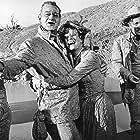 Maureen O'Hara, John Wayne, and Strother Martin in McLintock! (1963)