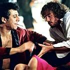 Val Kilmer and Eric Bogosian in Wonderland (2003)