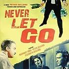 Peter Sellers, Elizabeth Sellars, and Richard Todd in Never Let Go (1960)