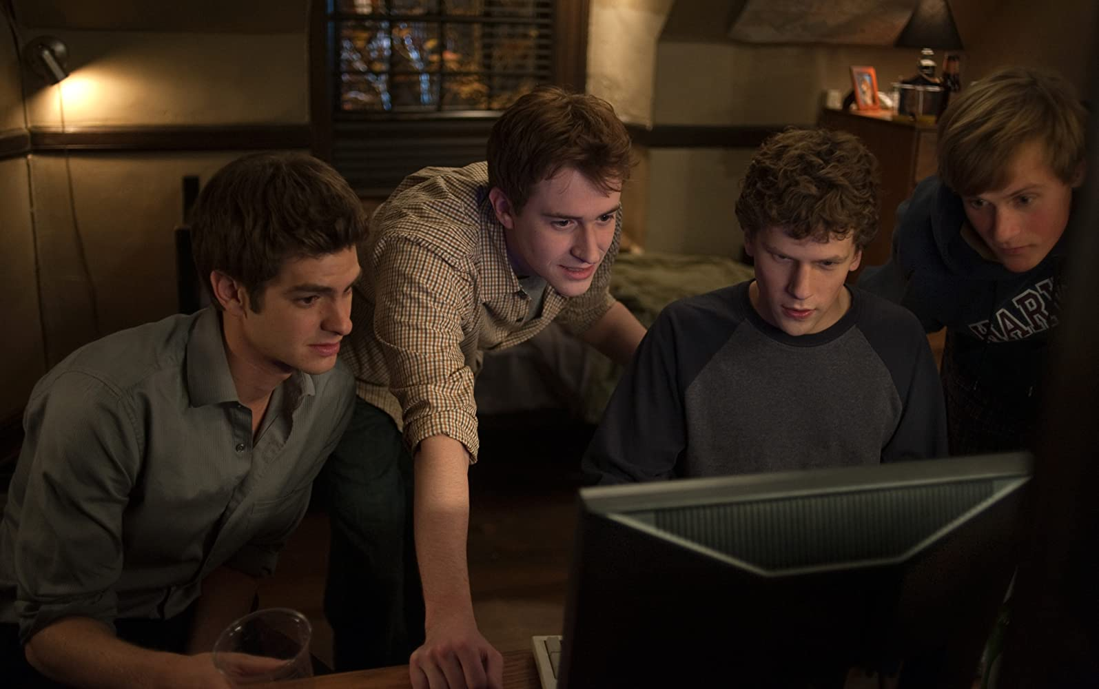 Joseph Mazzello, Jesse Eisenberg, Andrew Garfield, and Patrick Mapel in The Social Network (2010)
