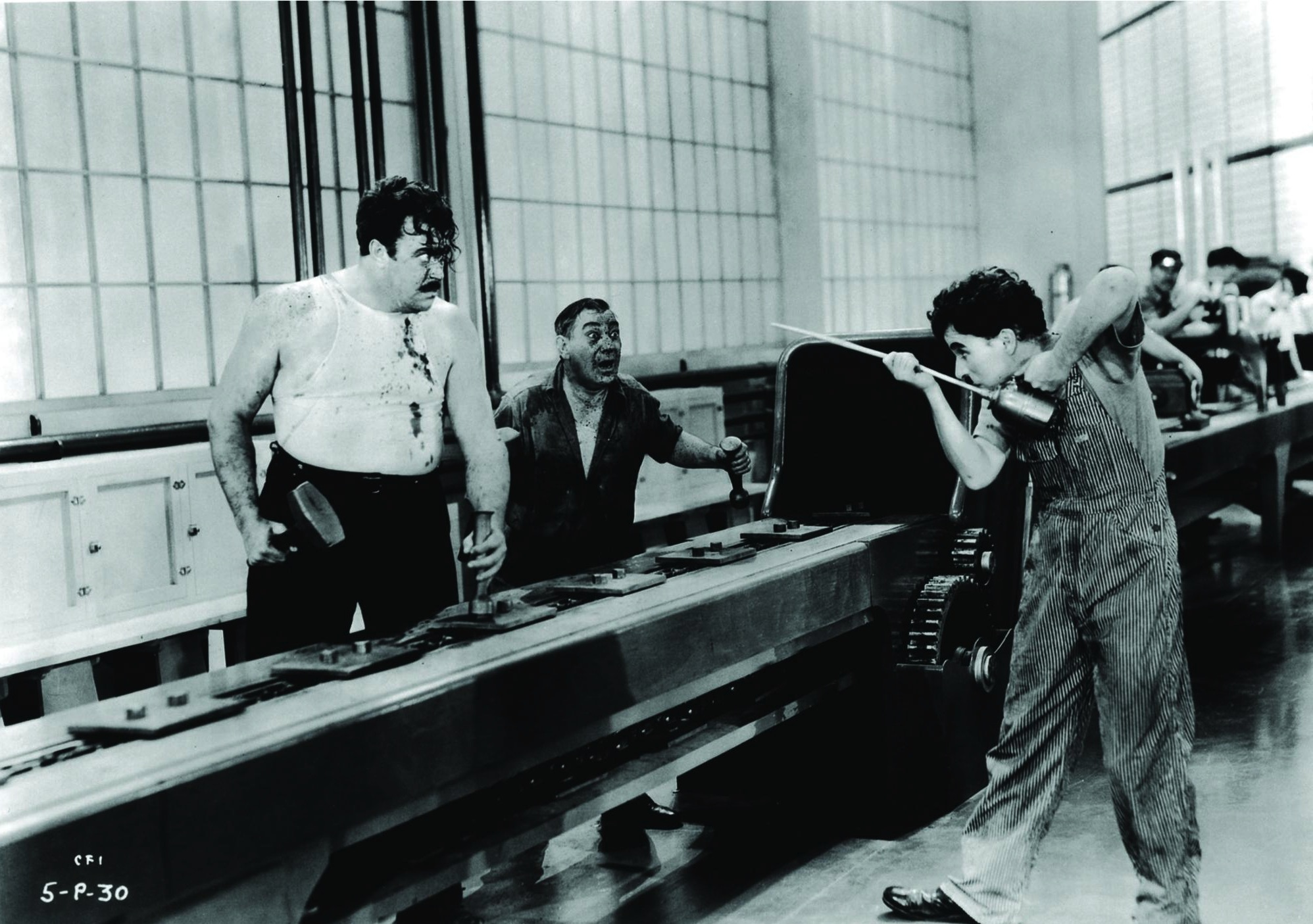 Charles Chaplin, Heinie Conklin, and Tiny Sandford in Modern Times (1936)