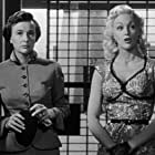 Jan Sterling and Phyllis Thaxter in Women's Prison (1955)