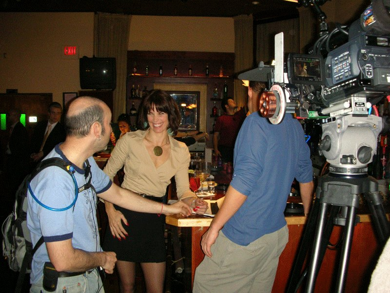 Alexandra Paul with actor Bryan Fisher and camera operator Adam Metzler on the set of He's Such a Girl 2007