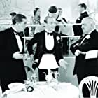 Fred Astaire, Edward Everett Horton, and Paul Porcasi in The Gay Divorcee (1934)