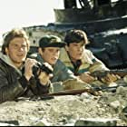Charlie Sheen, Patrick Swayze, and C. Thomas Howell in Red Dawn (1984)