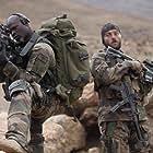 Djimon Hounsou and Denis Ménochet in Forces spéciales (2011)