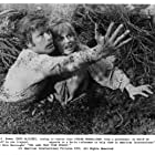 Doug McClure and Susan Penhaligon in The Land That Time Forgot (1974)