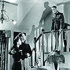 John Wayne, Joan Crawford, and Henry Daniell in Reunion in France (1942)