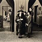 Charles Chaplin, Laura Anson, Gladys Baxter, Harry Maynard, and Edna Purviance in The Idle Class (1921)
