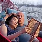 Bruce Willis and Qing Xu in Looper (2012)