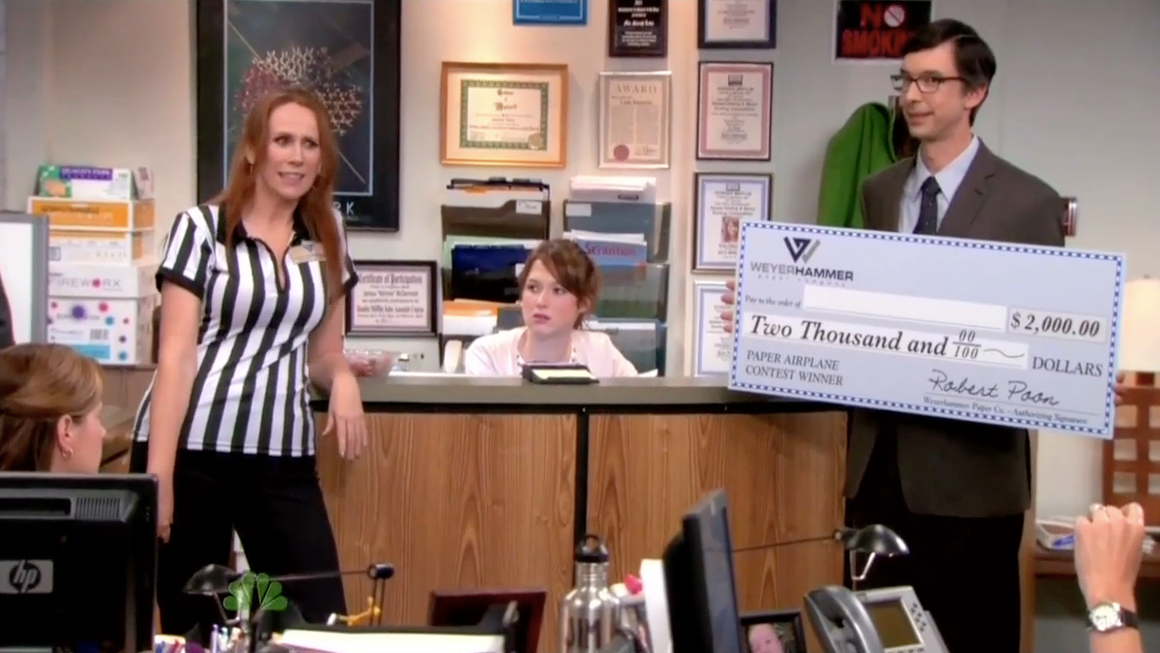 Todd Aaron Brotze as Robert in The Office, with Ellie Kemper and Catherine Tate