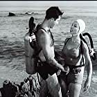 Pamela Duncan and Richard Garland in Attack of the Crab Monsters (1957)