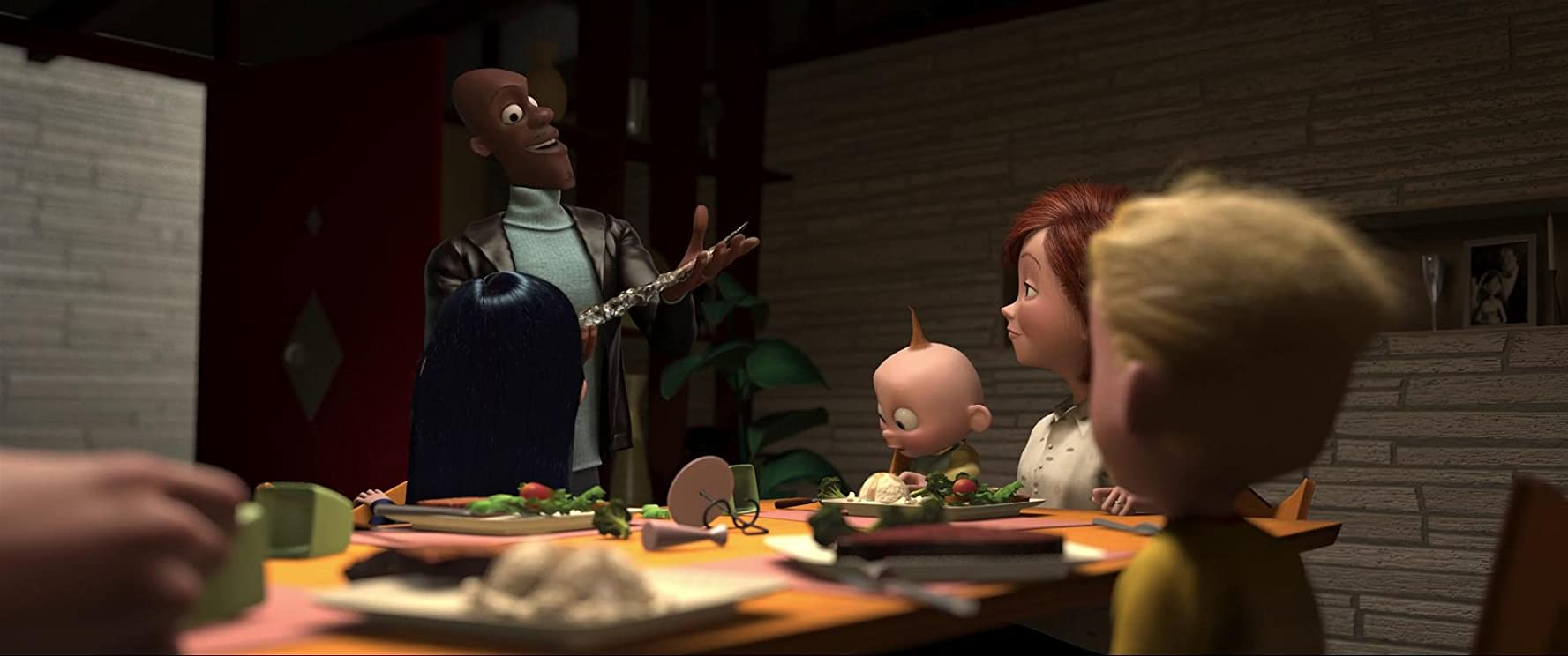 Samuel L. Jackson, Holly Hunter, Sarah Vowell, and Spencer Fox in The Incredibles (2004)