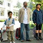 Martin Lawrence, Raven-Symoné, and Eshaya Draper in College Road Trip (2008)