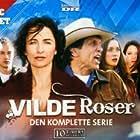 Kim Huffman, Steve Byers, Michelle Harrison, Gary Hudson, and Sarah Power in Wild Roses (2009)
