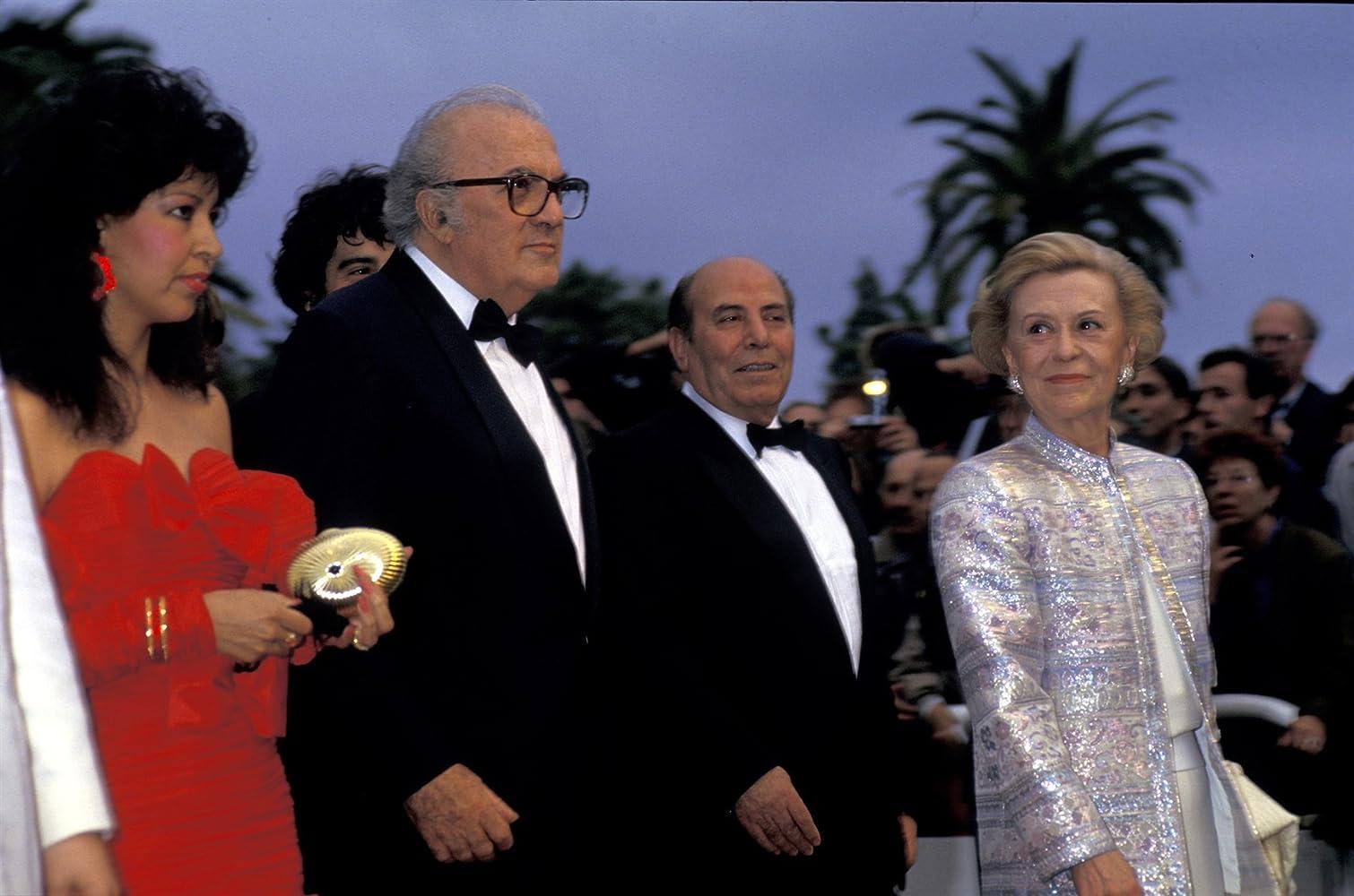 Federico Fellini, Marie-Laurence Harot, and Giulietta Masina