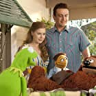 Amy Adams, Jason Segel, and Kermit the Frog in The Muppets (2011)