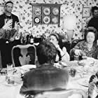 Emilio Estevez, Kathy Bates, Lane Smith, and Kimberly Williams-Paisley in The War at Home (1996)