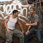 Paul Walker and David Belle in Brick Mansions (2014)