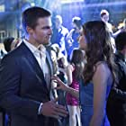 Willa Holland and Stephen Amell in Arrow (2012)