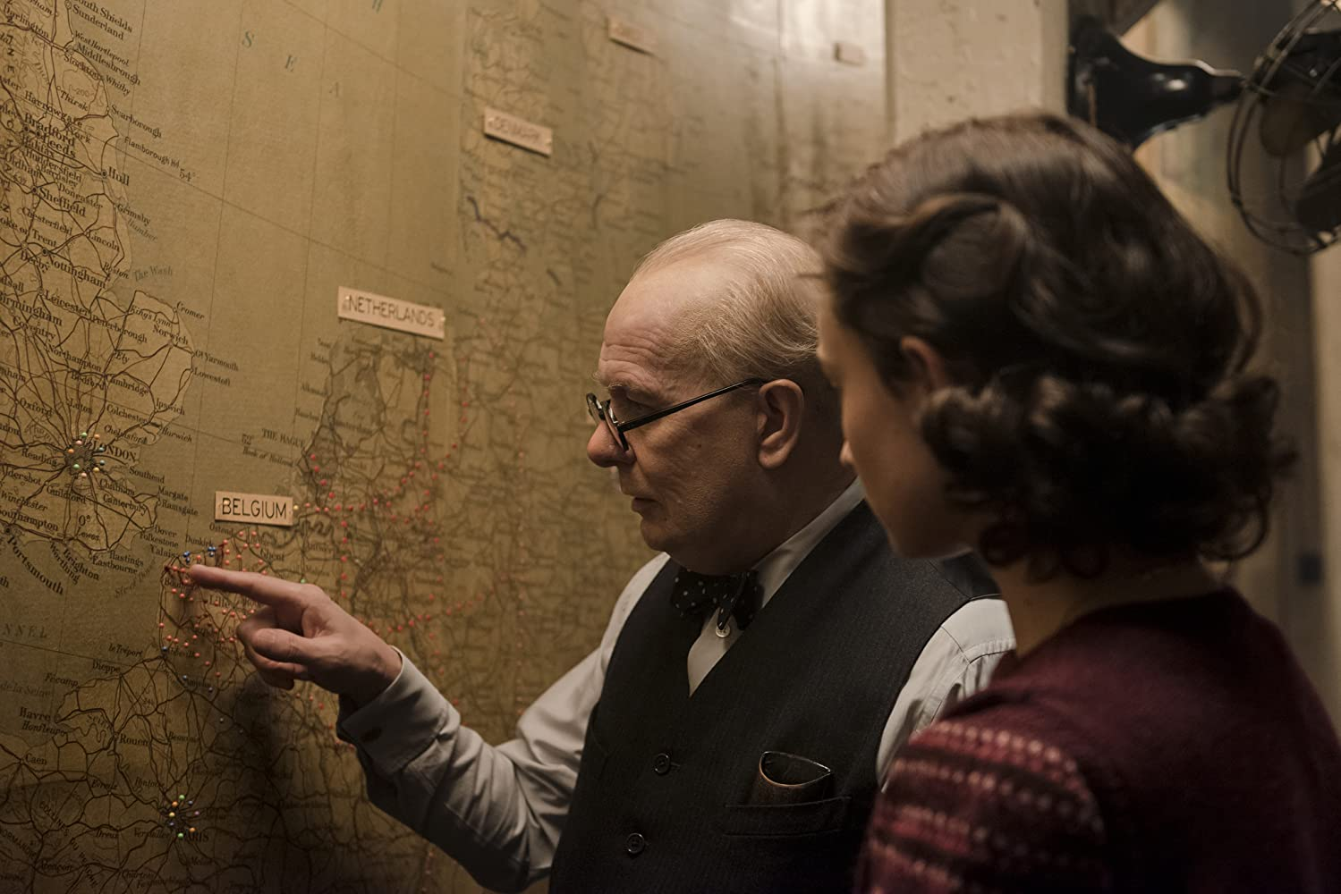 Winston Churchill pointing at the map
