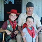 """Mitchel Musso, Robert Duvall, and Marc Musso on the set of """"Secondhand Lions""""."""