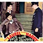 Oliver Hardy, Chester A. Bachman, and Stan Laurel in Pack Up Your Troubles (1932)