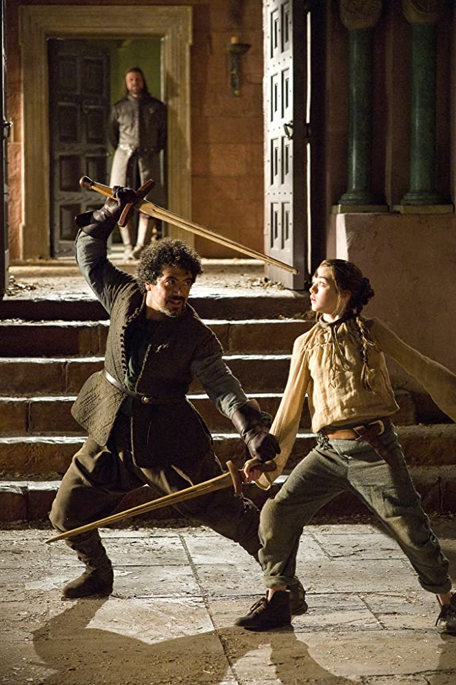 Sean Bean, Miltos Yerolemou, and Maisie Williams in Game of Thrones (2011)