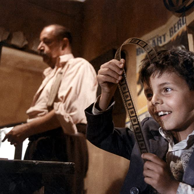 Salvatore Cascio and Philippe Noiret in Cinema Paradiso (1988)