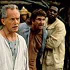 Lance Henriksen, Ernie Hudson, and David Argue in No Escape (1994)