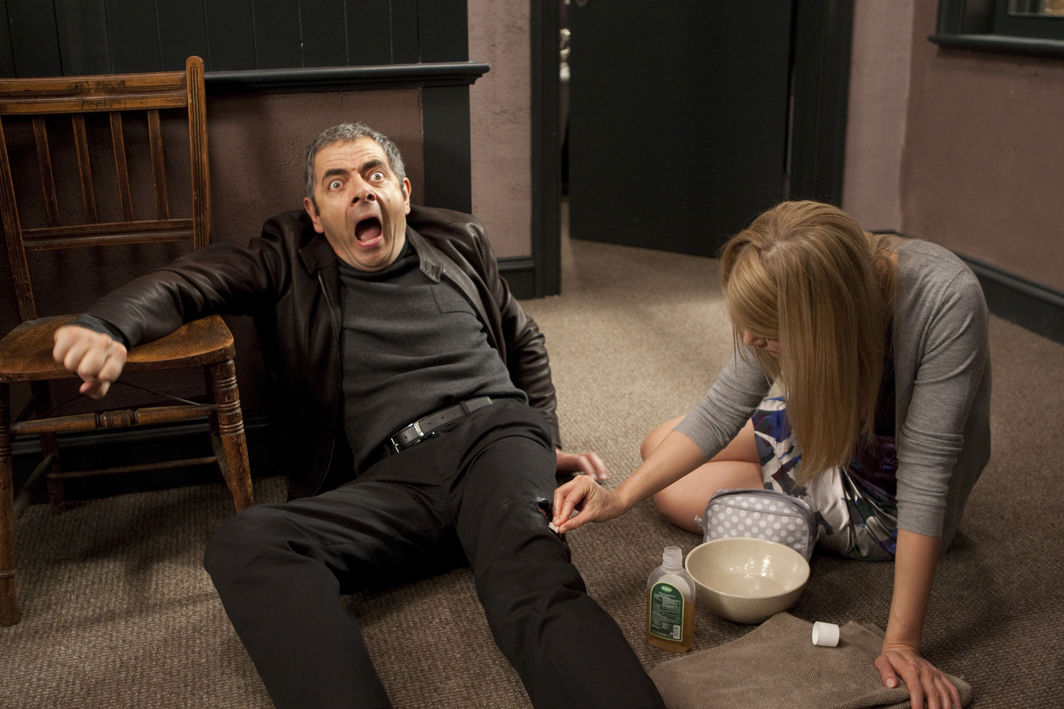 Rowan Atkinson and Rosamund Pike in Johnny English Reborn (2011)