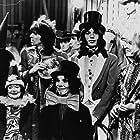 Mick Jagger, Yoko Ono, Keith Richards, and The Rolling Stones in The Rolling Stones Rock and Roll Circus (1996)